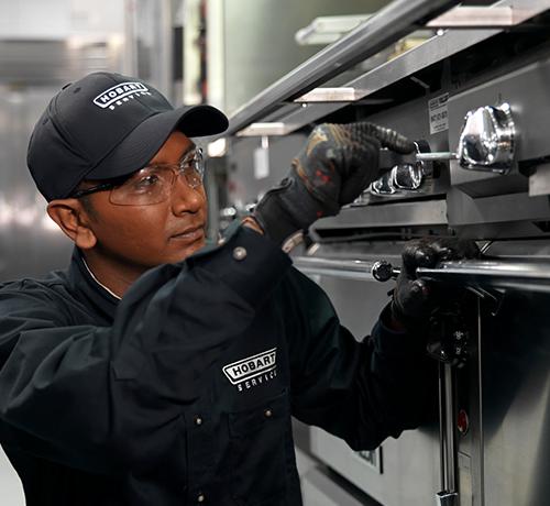 Service Technician Repairing Range