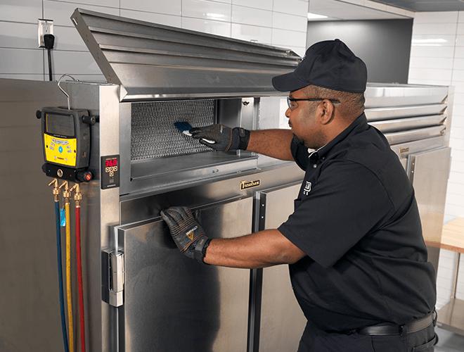 Service Technician servicing refrigerator
